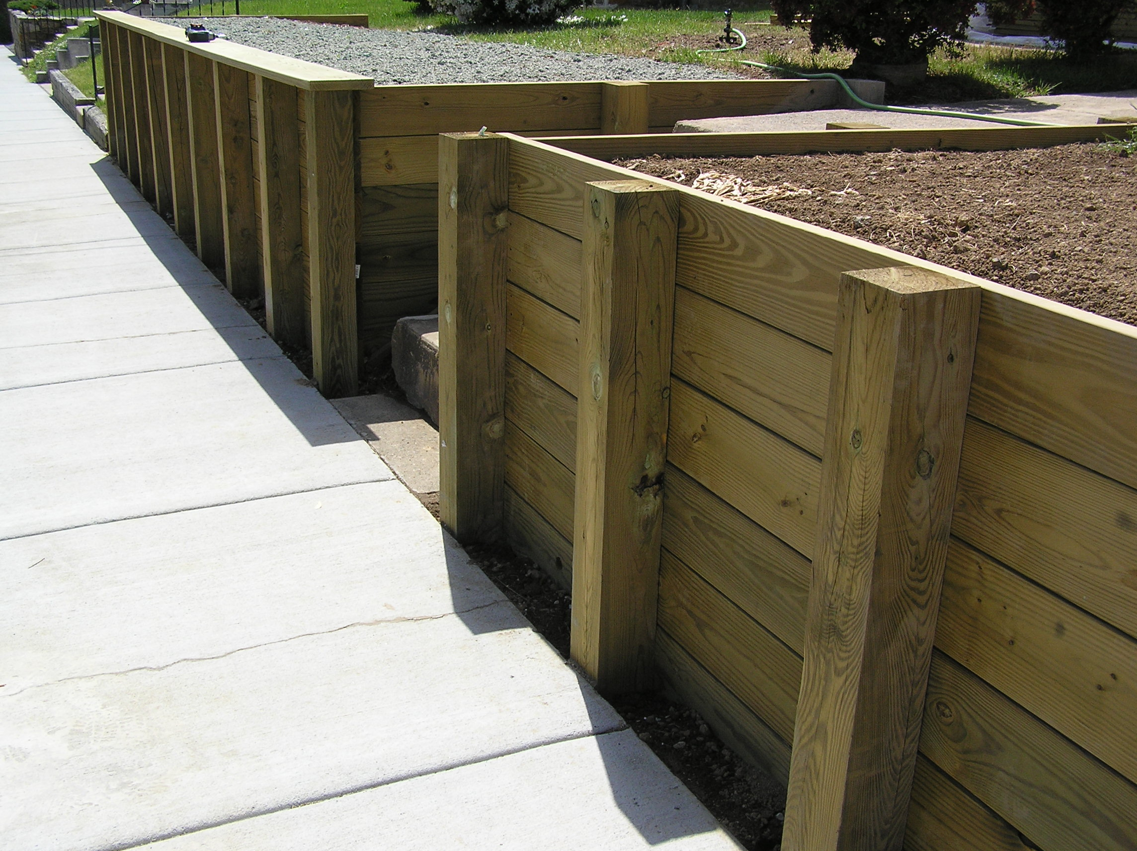Metal Post Retaining Wall Plank : Create a usable front yard with retaining wall