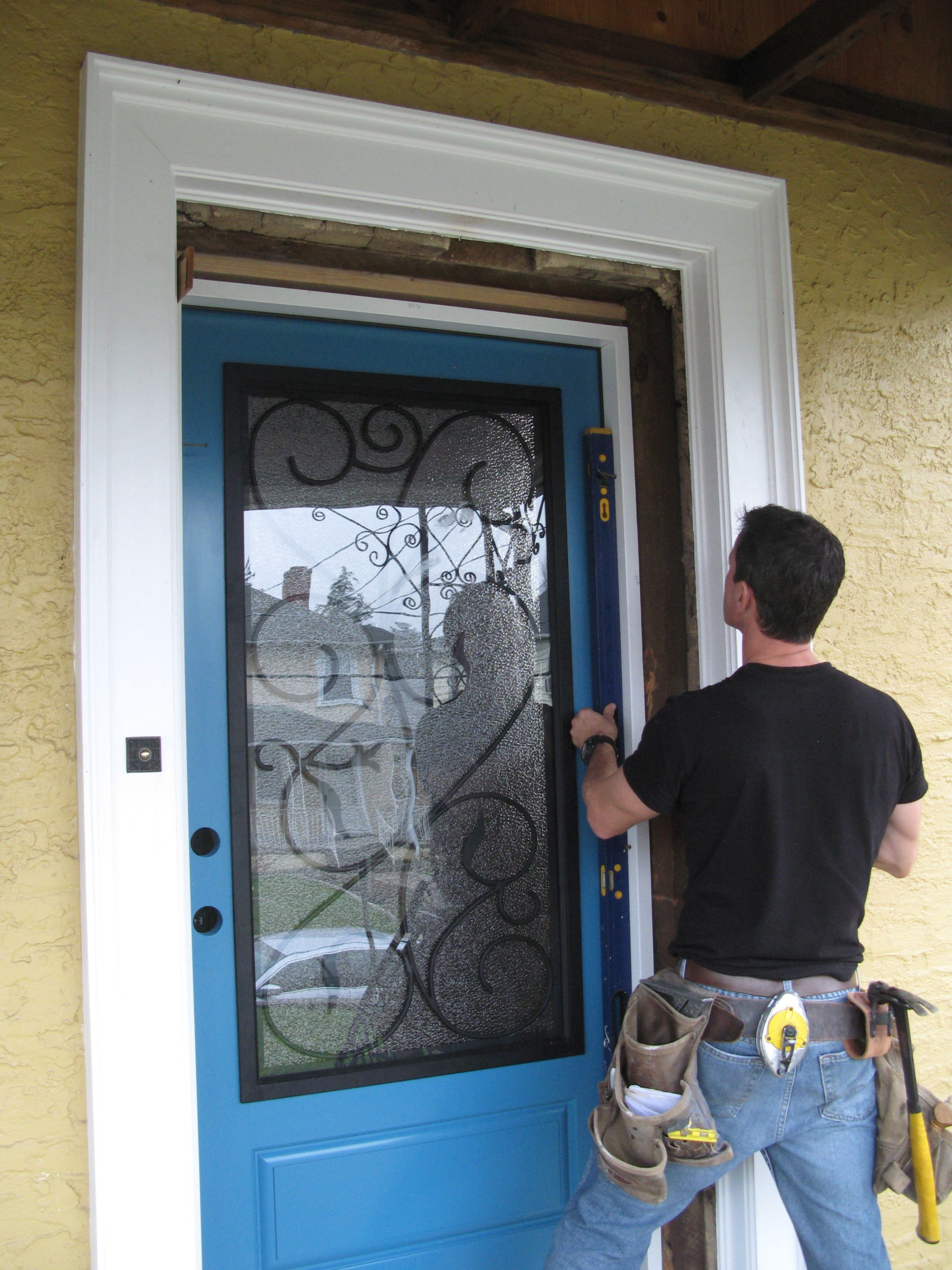 Installing a thermally efficient Therma-Tru fiberglass door.