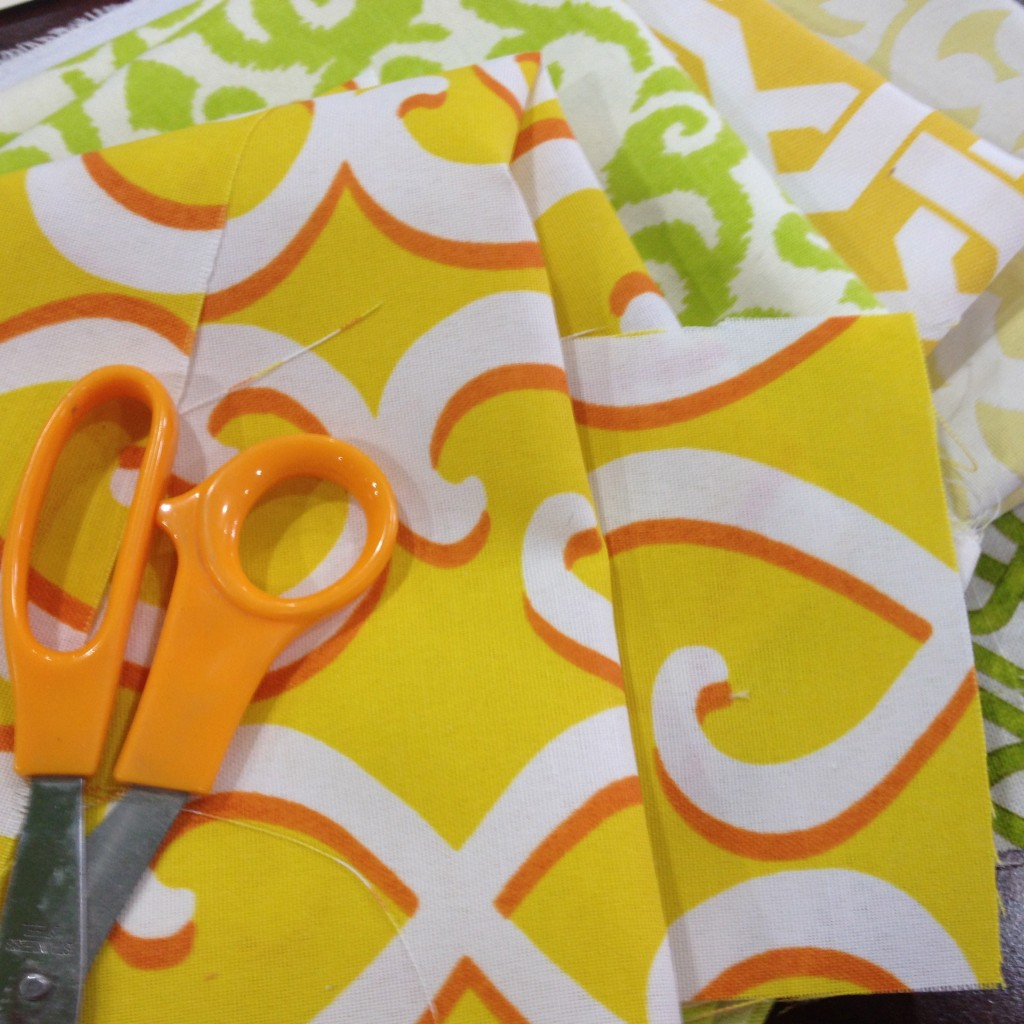 Theresa chose patterned fabrics in yellow and green from Jo-Ann Fabrics to update all of the chairs and tables at Lori's for 'Save My Bakery' on Food Network