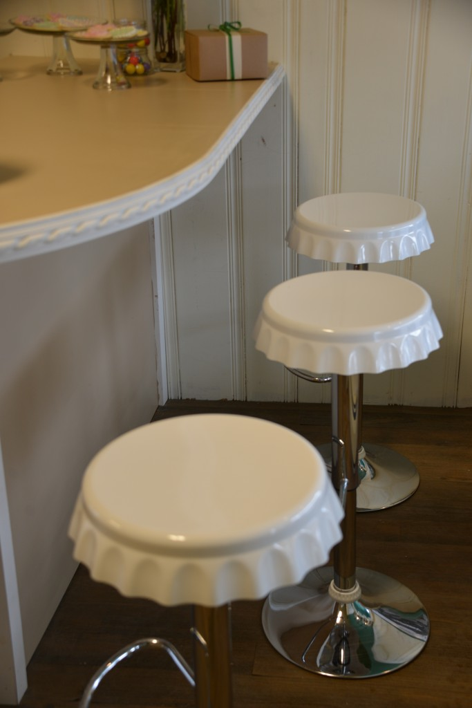 Save My Bakery AFTER: Schubert's now has seating. Little stools that look like upside-down pie plates add to the small town charm.