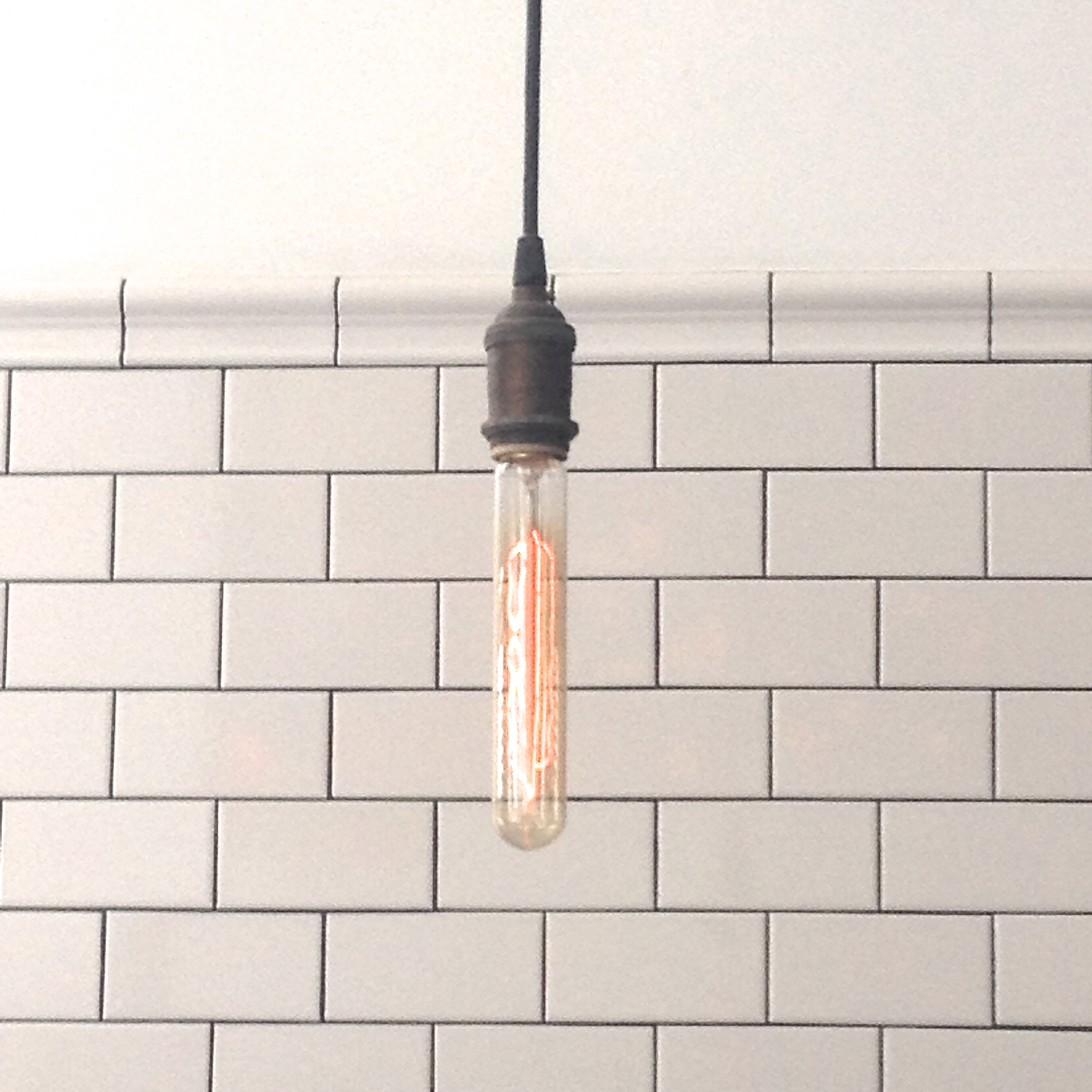 Two retro trends in one look Does an Edison bulb work with subway tile