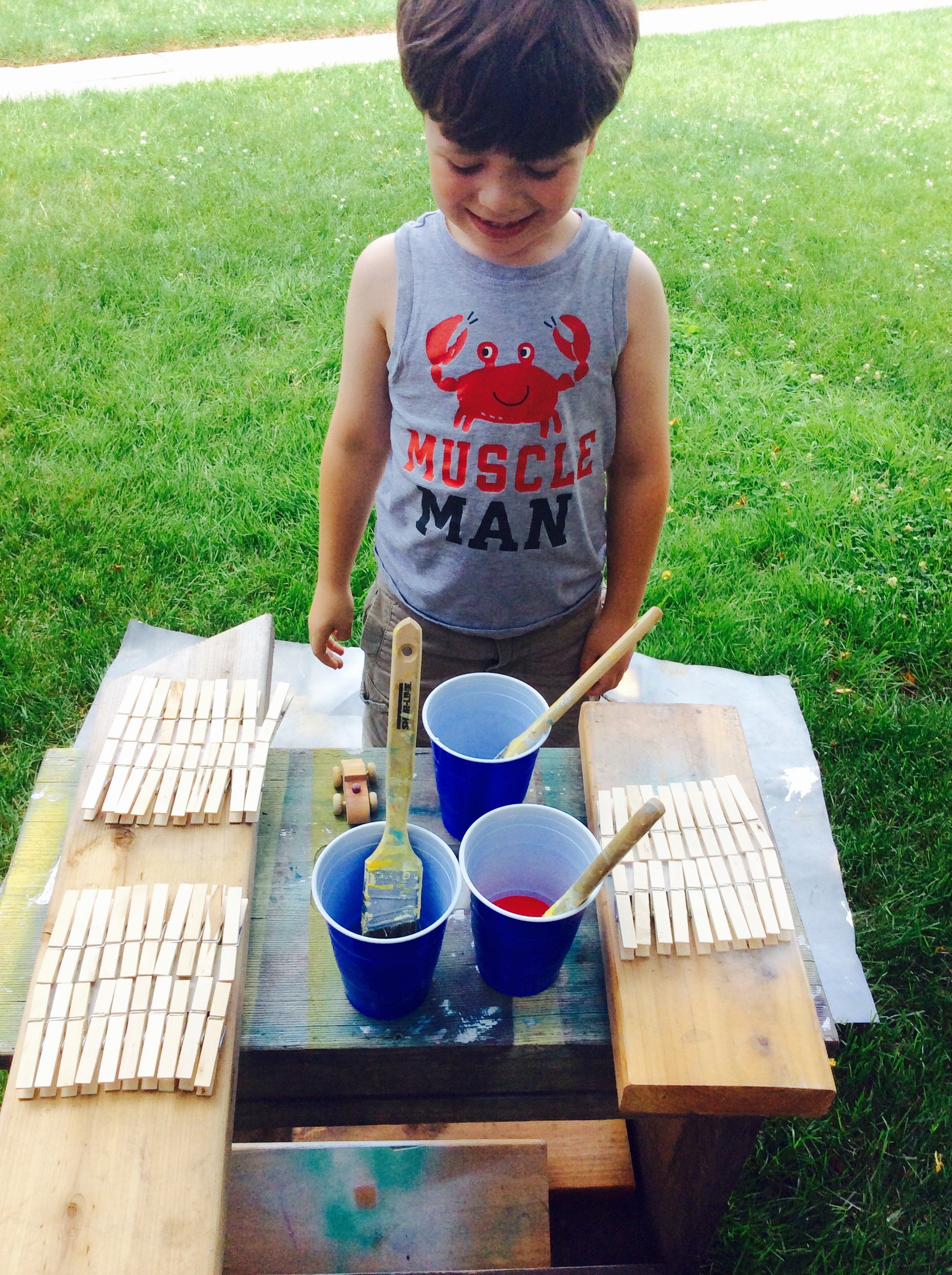 Jack is ready to start our kid craft for Fourth of July.