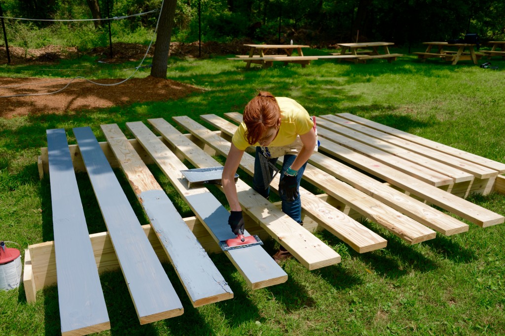 Before we put the wall slats in place, we primed the boards. Theresa discovered that this deck staining pad makes the process of staining really fast and easy. Shur-Line