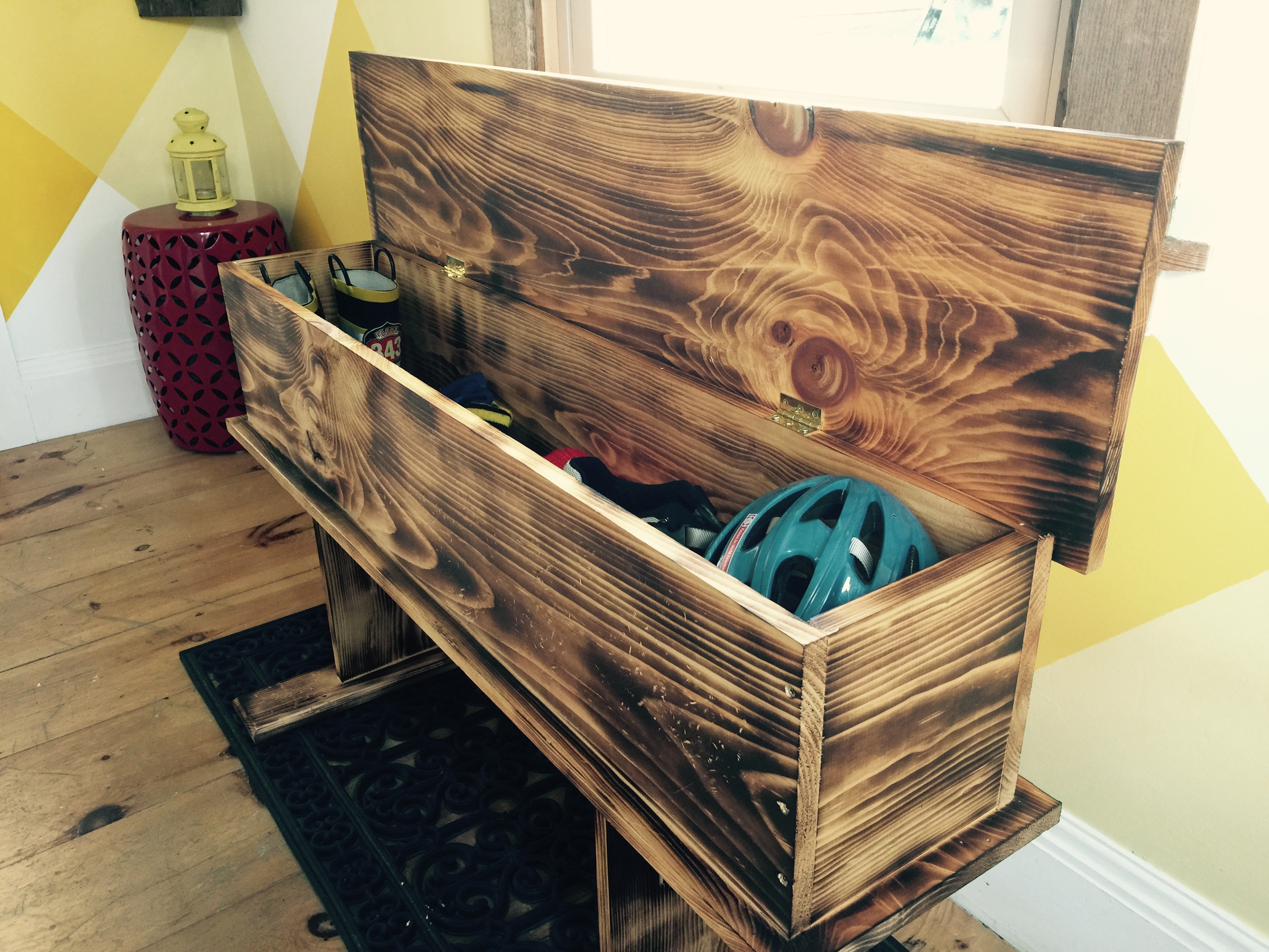 Love rustic? How to make a burnt wood storage bench
