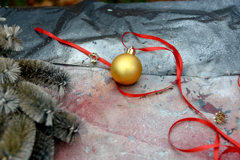 I tied a few gold and silver balls with ribbon and attached them to the wreath.