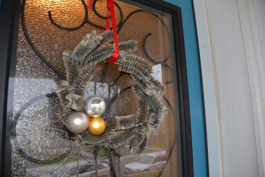 The wreath looks very festive on our door.