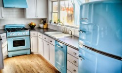 Blue is America's favorite color, so if you aren't sure of a color to choose in the kitchen, it's the safest bet. The color contrast aid in visually differentiating the parts of the kitchen - oven, refrigerator, counter - and the retro style increases a sense of comfort, too. Shown here is a Big Chill kitchen.