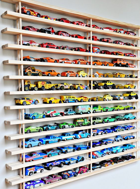 Diecast cars can be tough to store and sort, but not when you organize them as a wall art.
