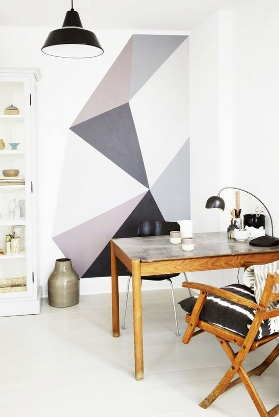 Gray geometric painted shapes are a calm and fun backdrop to this workspace