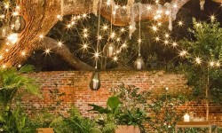 String lights and some festive decor make this backyard into a retreat