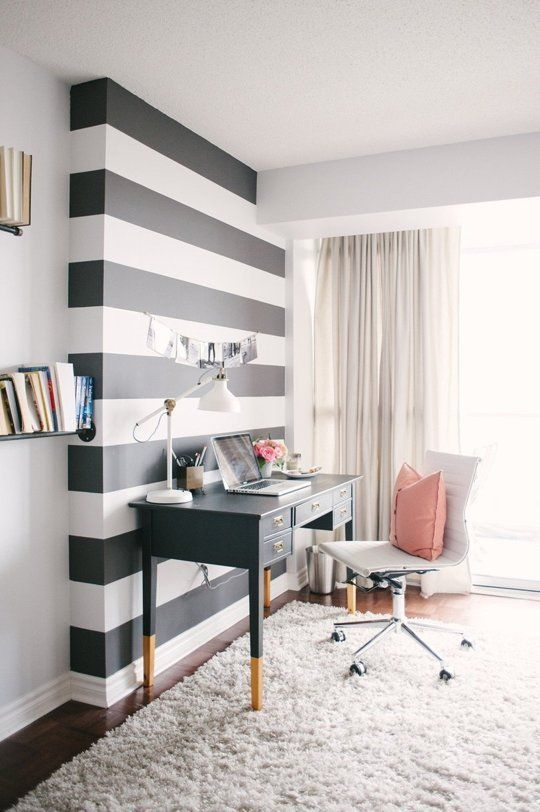 Celebrate the wall bump out with a horizontal black and white stripe gives drama and whimsy to a sophisticated space.