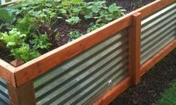 This galvanized steel and stained wood planter is visually easy to see, and helps define the yard.