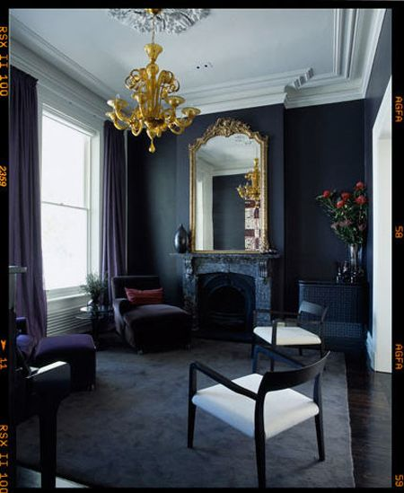 Darker colors on the walls and floor are enhanced by the darker colors