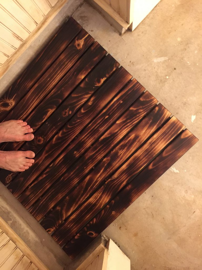 man cave bathroom design project make a burnt wood bath mat there are a million man cave design ideas and projects out there and this is one of them few however are finished with fire