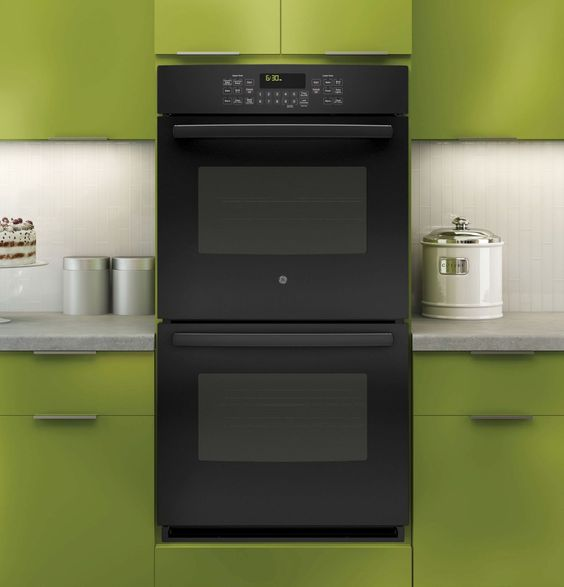 Glossy Green Cabinets Infuse Vitality To This Kitchen: This Year's Trend In Kitchen Colors. Is Black The New
