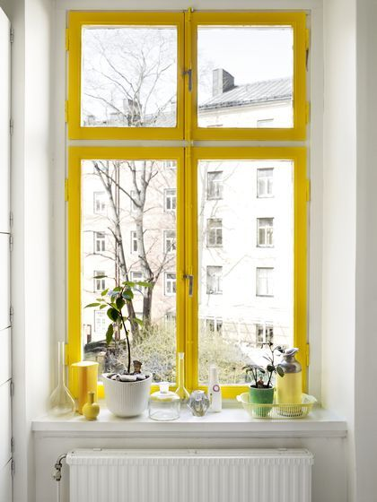 A yellow window frame can make even the dreariest rainy days a little brighter.