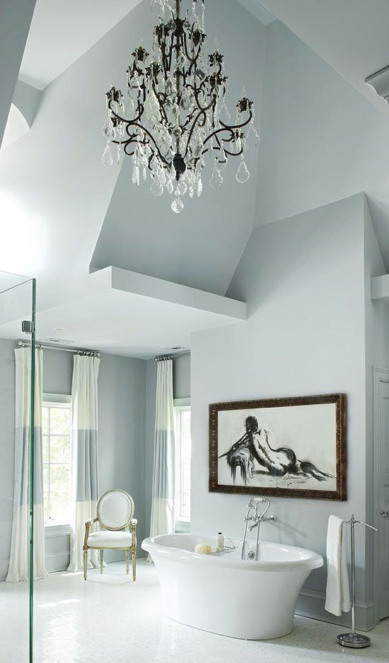 traditional home chandelier over bathtub